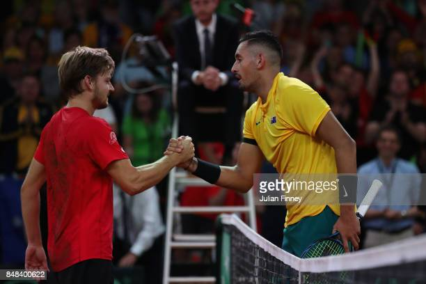 David Goffin of Belgium is congratulated by Nick Kyrgios of Australia after his four set win during day three of the Davis Cup World Group semi final...