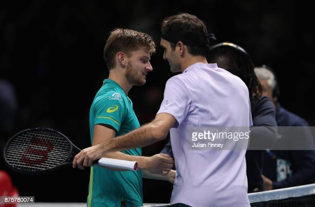 David Goffin of Belgium is congratulated by Roger Federer of Switzerland in the semi finals during day seven of the Nitto ATP World Tour Finals...