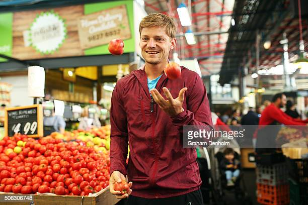 David Goffin of Belgium juggles apples during a visit to Prahran Market during day six of the 2016 Australian Open at Melbourne Park on January 23...