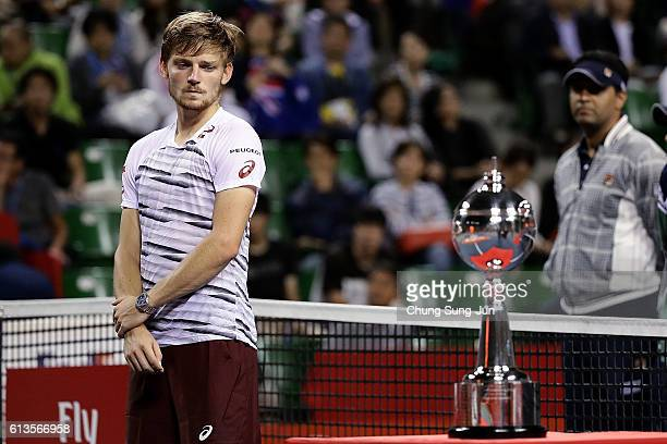 David Goffin of Belgium looks at winner's trophy after losing the men's singles final match against Nick Kyrgios of Australia on day seven of Rakuten...