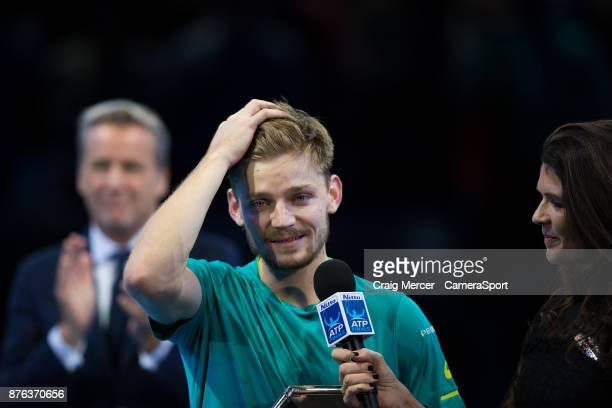 David Goffin of Belgium looks dejected as he is interviewed after his defeat by Grigor Dimitrov of Bulgaria in the Mens final at O2 Arena on November...