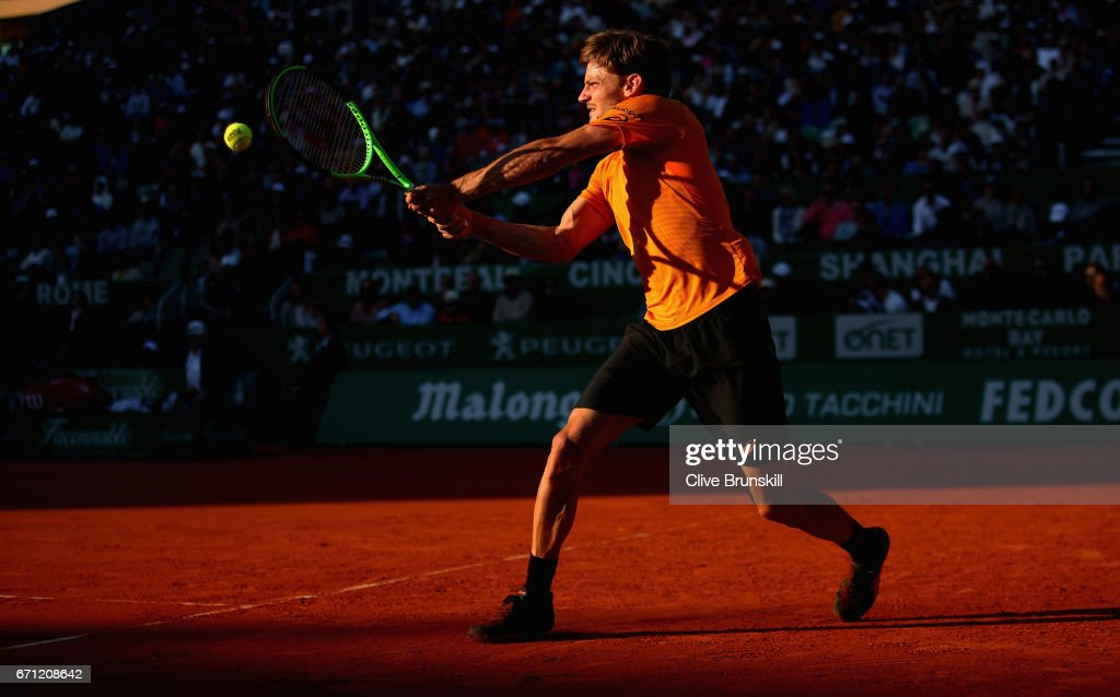 David Goffin of Belgium plays a backhand against Novak Djokovic of Serbia in their quarter final round match on day six of the Monte Carlo Rolex Masters at Monte-Carlo Sporting Club on April 21, 2017 in Monte-Carlo, Monaco.