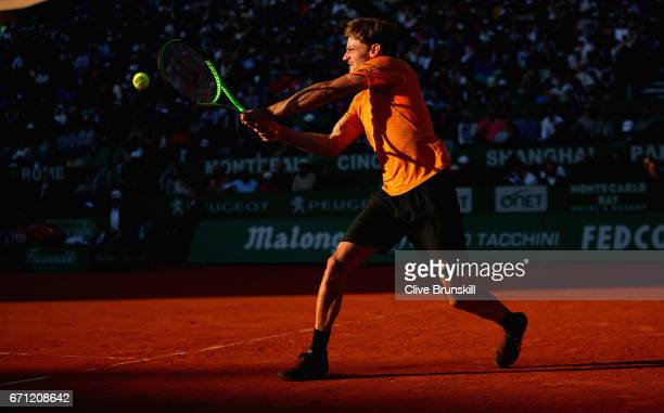 David Goffin of Belgium plays a backhand against Novak Djokovic of Serbia in their quarter final round match on day six of the Monte Carlo Rolex...