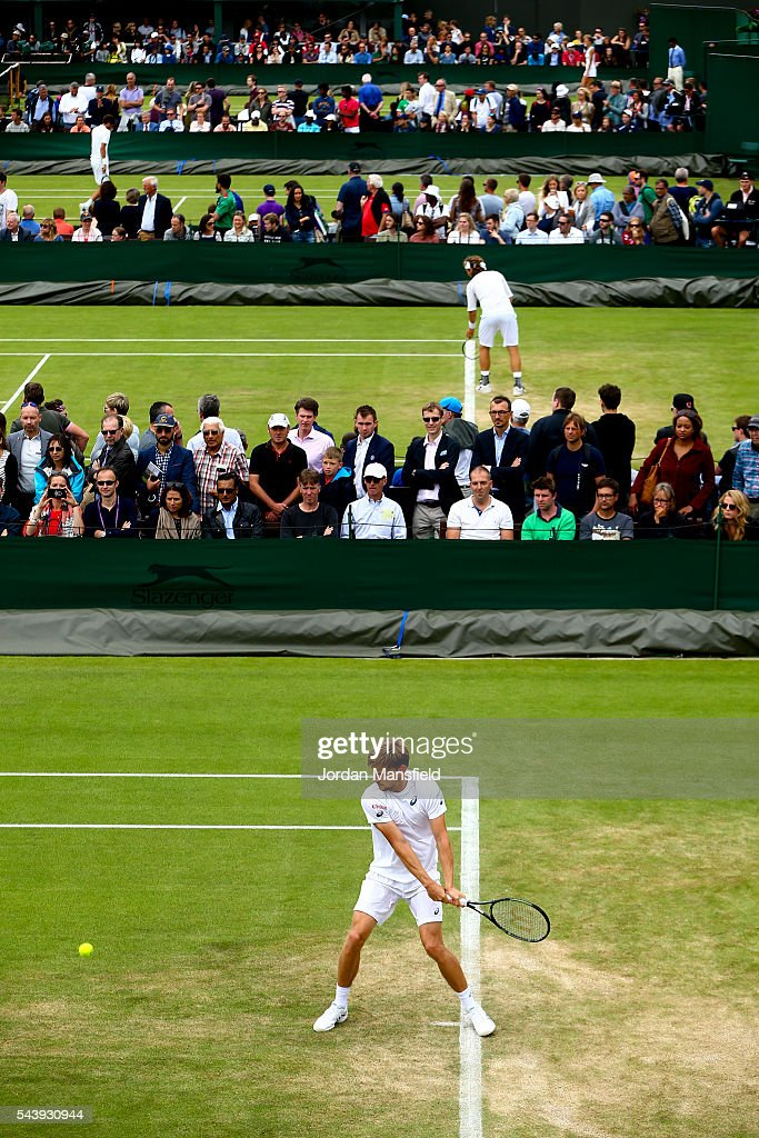 <a gi-track='captionPersonalityLinkClicked' href=/galleries/search?phrase=David+Goffin&family=editorial&specificpeople=2291768 ng-click='$event.stopPropagation()'>David Goffin</a> of Belgium plays a backhand during his Men's second round match against Edouard Roger-Vasselin of France during day four of the Wimbledon Lawn Tennis Championships at the All England Lawn Tennis and Croquet Club on June 30, 2016 in London, England.
