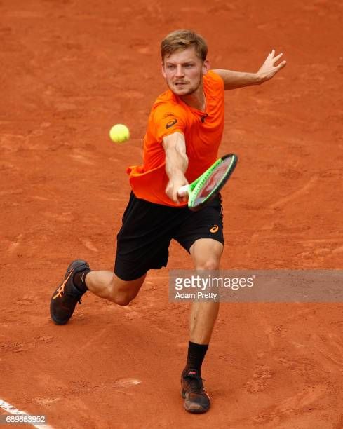 David Goffin of Belgium plays a backhand during the mens singles first round match against PaulHenri Mathieu of France on day two of the 2017 French...