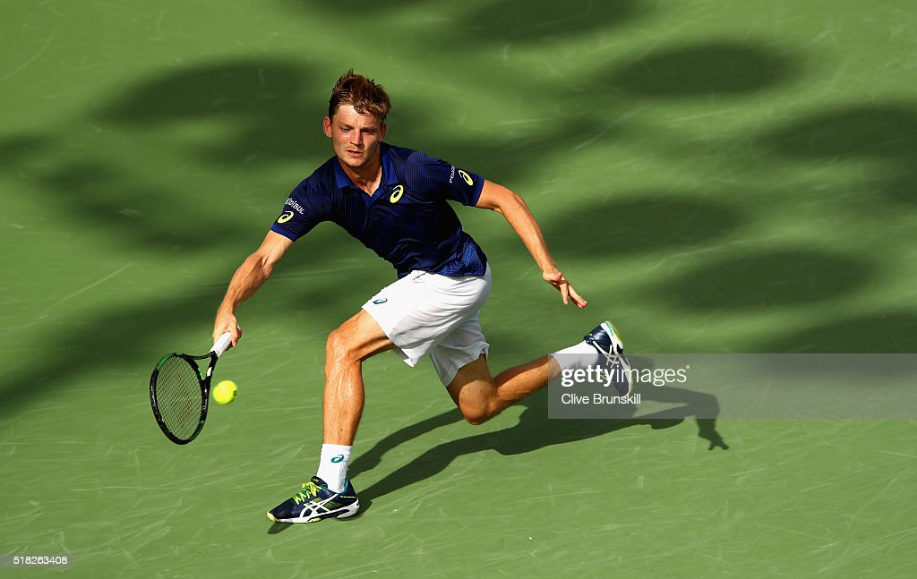 <a gi-track='captionPersonalityLinkClicked' href=/galleries/search?phrase=David+Goffin&family=editorial&specificpeople=2291768 ng-click='$event.stopPropagation()'>David Goffin</a> of Belgium plays a forehand against Gilles Simon of France in their quarter final match during the Miami Open Presented by Itau at Crandon Park Tennis Center on March 30, 2016 in Key Biscayne, Florida.