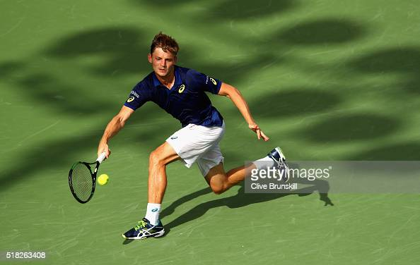 David Goffin of Belgium plays a forehand against Gilles Simon of France in their quarter final match during the Miami Open Presented by Itau at...