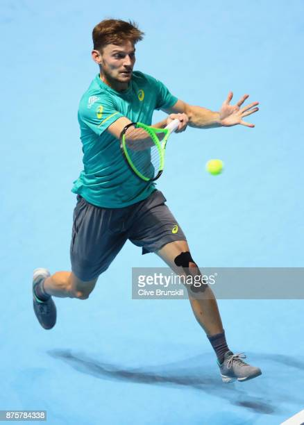 David Goffin of Belgium plays a forehand during his three set victory against Roger Federer of Switzerland in their semi final match the Nitto ATP...