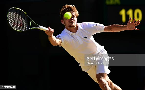 David Goffin of Belgium plays a forehand in his Gentlemen's Singles Fourth Round match against Stanislas Wawrinka of Switzerland during day seven of...