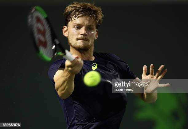 David Goffin of Belgium plays a forehand in his match against Nick Kyrgios of Australia at Crandon Park Tennis Center on March 28 2017 in Key...