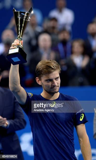 David Goffin of Belgium poses with the second place trophy after the men's final singles tennis match against Grigor Dimitrov of Bulgaria within 2017...