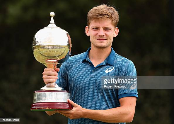 David Goffin of Belgium poses with the winners trophy after winning his match against Feliciano Lopez of Spain during day four of the 2016 Kooyong...