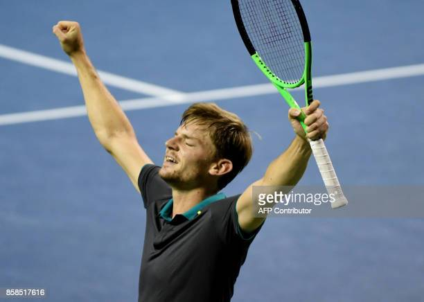 David Goffin of Belgium reacts after defeating Diego Schwartzman of Argentina during their men's singles semifinal match of the Japan Open tennis...