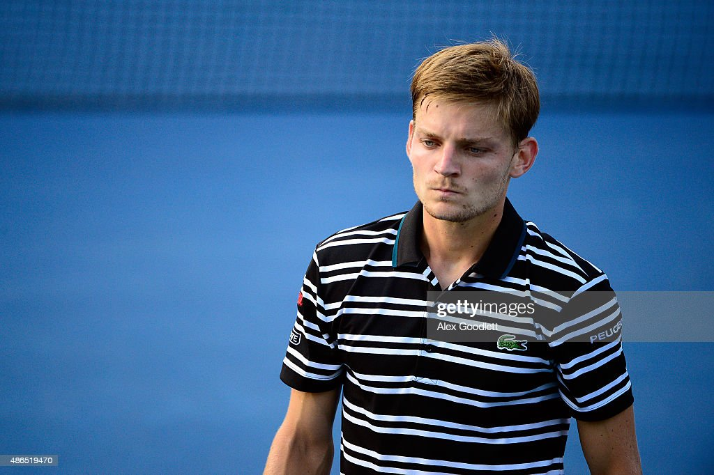 <a gi-track='captionPersonalityLinkClicked' href=/galleries/search?phrase=David+Goffin&family=editorial&specificpeople=2291768 ng-click='$event.stopPropagation()'>David Goffin</a> of Belgium reacts against Roberto Bautista Agut of Spain during their Men's Singles Third Round match on Day Five of the 2015 US Open at the USTA Billie Jean King National Tennis Center on September 4, 2015 in the Flushing neighborhood of the Queens borough of New York City.