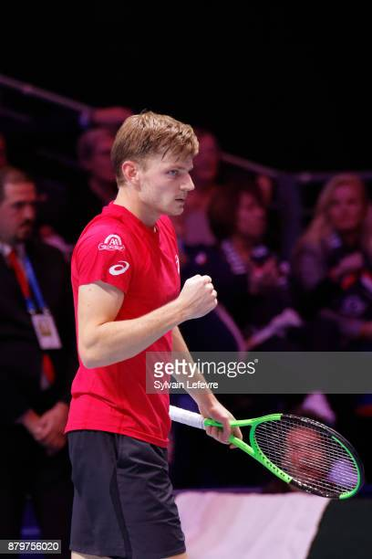 David Goffin of Belgium reacts during his match against JoWilfried Tsonga of France during day 3 of the Davis Cup World Group final between France...