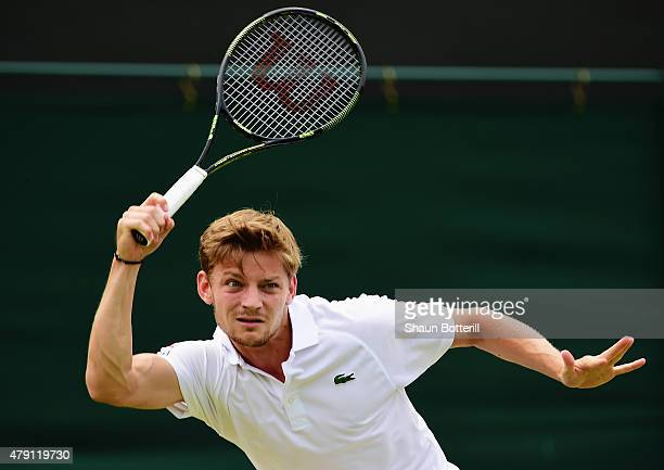 David Goffin of Belgium returns a shot in his Gentlemens Singles Second Round match against Liam Broady of Great Britain during day three of the...