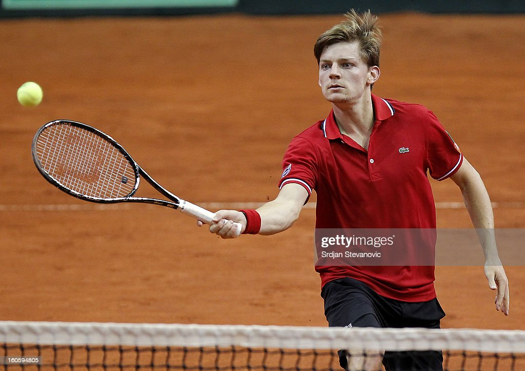 David Goffin of Belgium returns a shot to Boris Pasanski of Serbia during the third day of the Davis Cup singles first round match between Belgium and Serbia, at Spirou dome February 03, 2013 in Charleroi, Belgium.