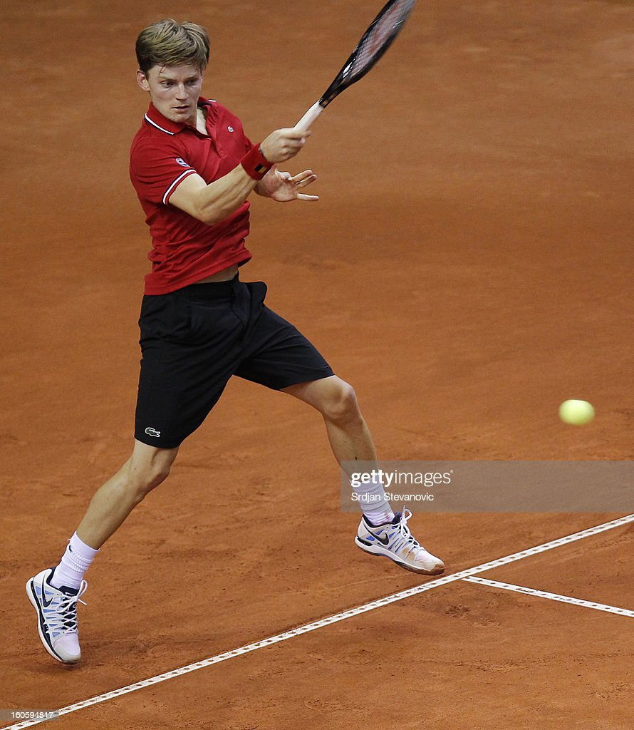 David Goffin of Belgium returns a shot to Boris Pasanski of Serbia during third day of the Davis Cup singles first round match between Belgium and Serbia, at Spirou dome February 03, 2013 in Charleroi, Belgium.