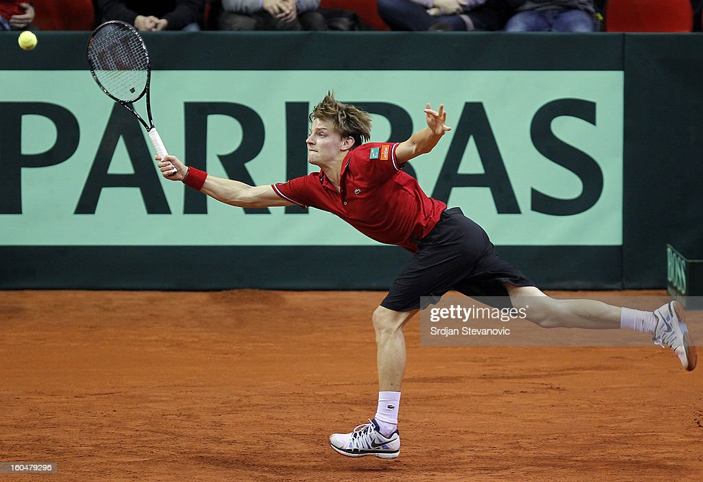 David Goffin of Belgium returns a shot to Viktor Troicki of Serbia during the Davis Cup singles first round match between Belgium and Serbia, at Spirou dome February 01, 2013 in Charleroi, Belgium.