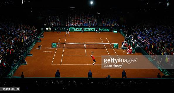 David Goffin of Belgium serves during the singles match against Kyle Edmund of Great Britain on day one of the Davis Cup Final 2015 at Flanders Expo...