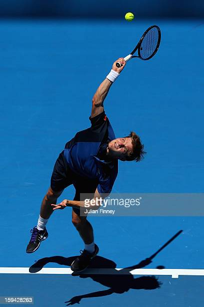David Goffin of Belgium serves in his first round match against Fernando Verdasco of Spain during day one of the 2013 Australian Open at Melbourne...