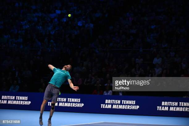 David Goffin of Belgium serves in his Singles match against Dominic Thiem of Austria during day six of the Nitto ATP World Tour Finals at O2 Arena on...