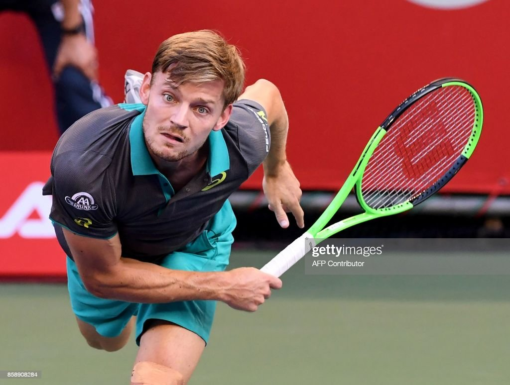 David Goffin of Belgium serves to Adrian Mannarino of France during their men's singles final match during the Japan Open tennis tournament in Tokyo on October 8, 2017. / AFP PHOTO / Toru Yamanaka