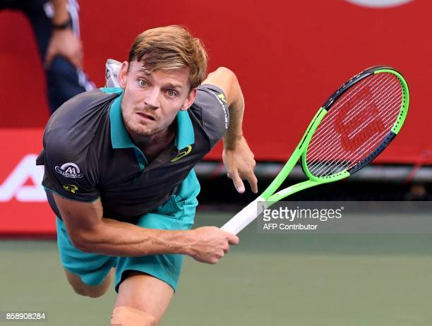 David Goffin of Belgium serves to Adrian Mannarino of France during their men's singles final match during the Japan Open tennis tournament in Tokyo...