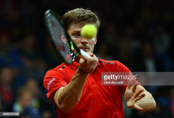 David Goffin of Belgium volleys during the singles match against Kyle Edmund of Great Britain on day one of the Davis Cup Final 2015 at Flanders Expo...