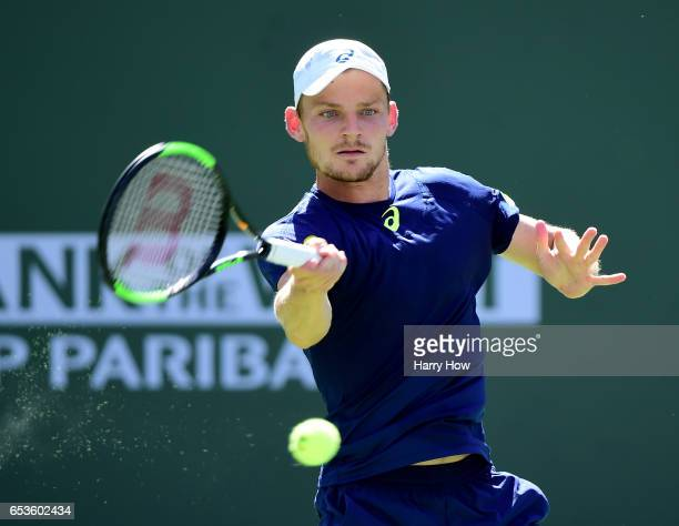 David Goffin of Belgiumhis a forehand in his loss to Pablo Cuevas of Uruguay during the BNP Paribas at Indian Wells Tennis Garden on March 15 2017 in...