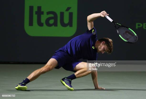 David Goffin of Belguim falls agains tNick Kyrgios of Australia during Day 9 of the Miami Open at Crandon Park Tennis Center on March 28 2017 in Key...