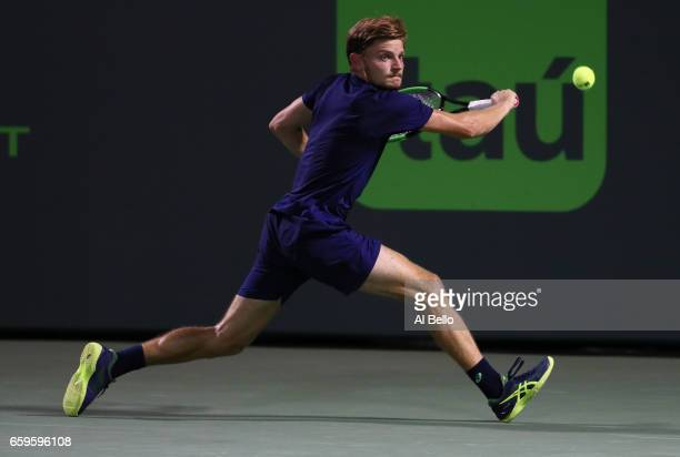 David Goffin of Belguim returns a shot againstNick Kyrgios of Australia during Day 9 of the Miami Open at Crandon Park Tennis Center on March 28 2017...