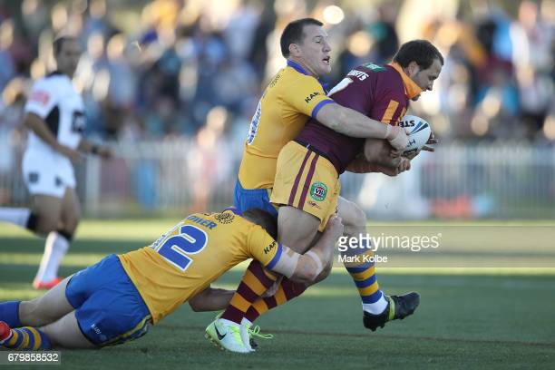 David Gower and Paul Gallen of City tackle Tyrone Roberts of Country during the 2017 City versus Country Origin match at Glen Willow Sports Ground on...