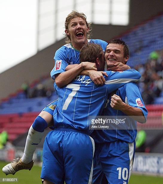 David Graham of Wigan Athletic celebrates his goal with Jimmy Bullard and Lee McCulloch during the Coca Cola Championship match between Wigan...