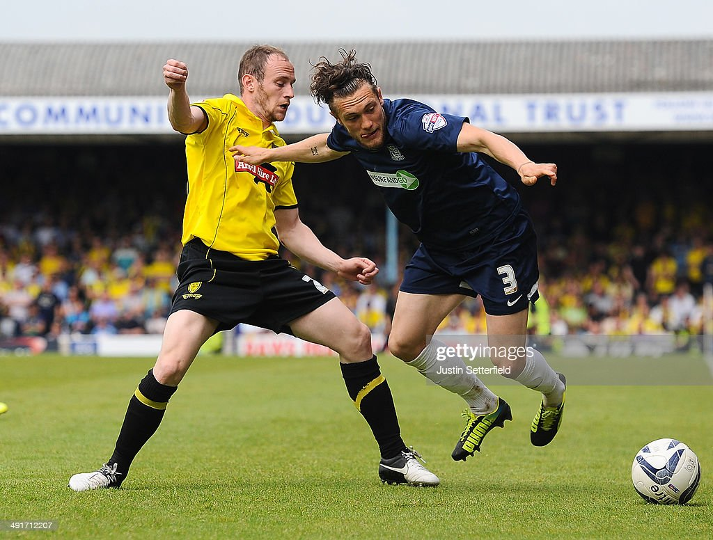 David Gray of Burton Albion and Ben Coker of Southend United in action during the Sky Bet League 2 Play Off Semi Final second leg match between Southend United and Burton Albion at Roots Hall on May 17, 2014 in Southend, England.