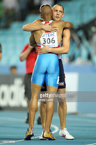 David Greene of Great Britain is congratulated by Felix Sanchez of Dominican Republic after claiming gold in the men's 400 metres hurdles final...