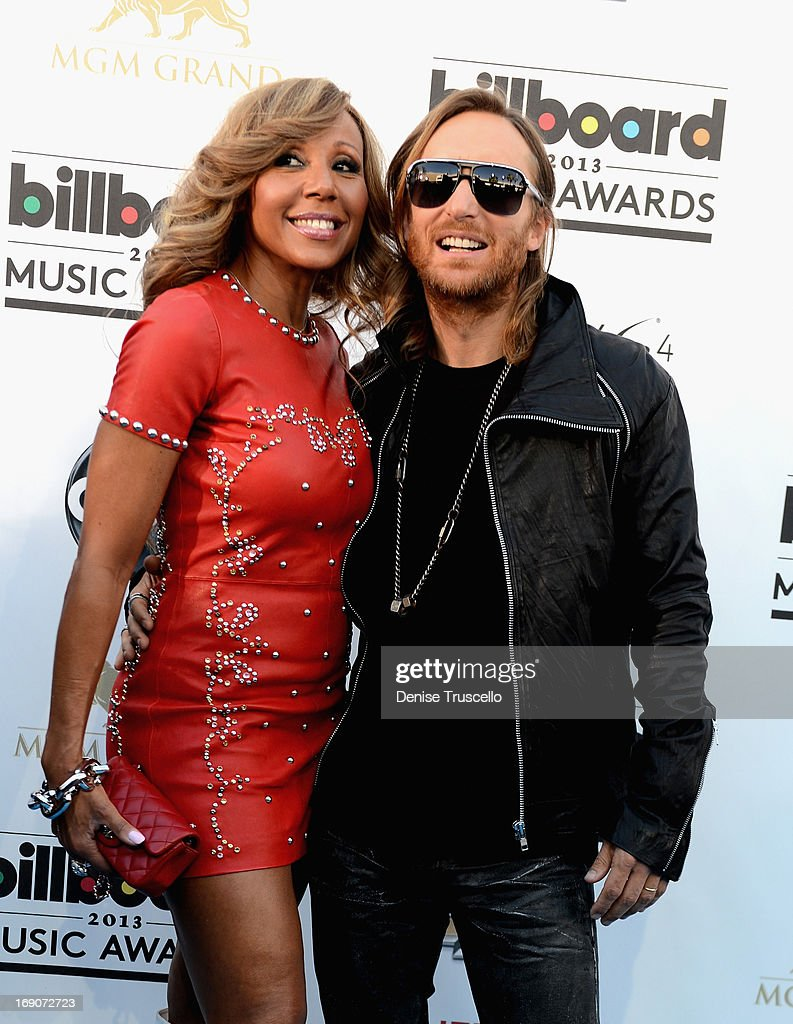 DJ David Guetta and Cathy Guetta arrive at the 2013 Billboard Music Awards at the MGM Grand Garden Arena on May 19 2013 in Las Vegas Nevada