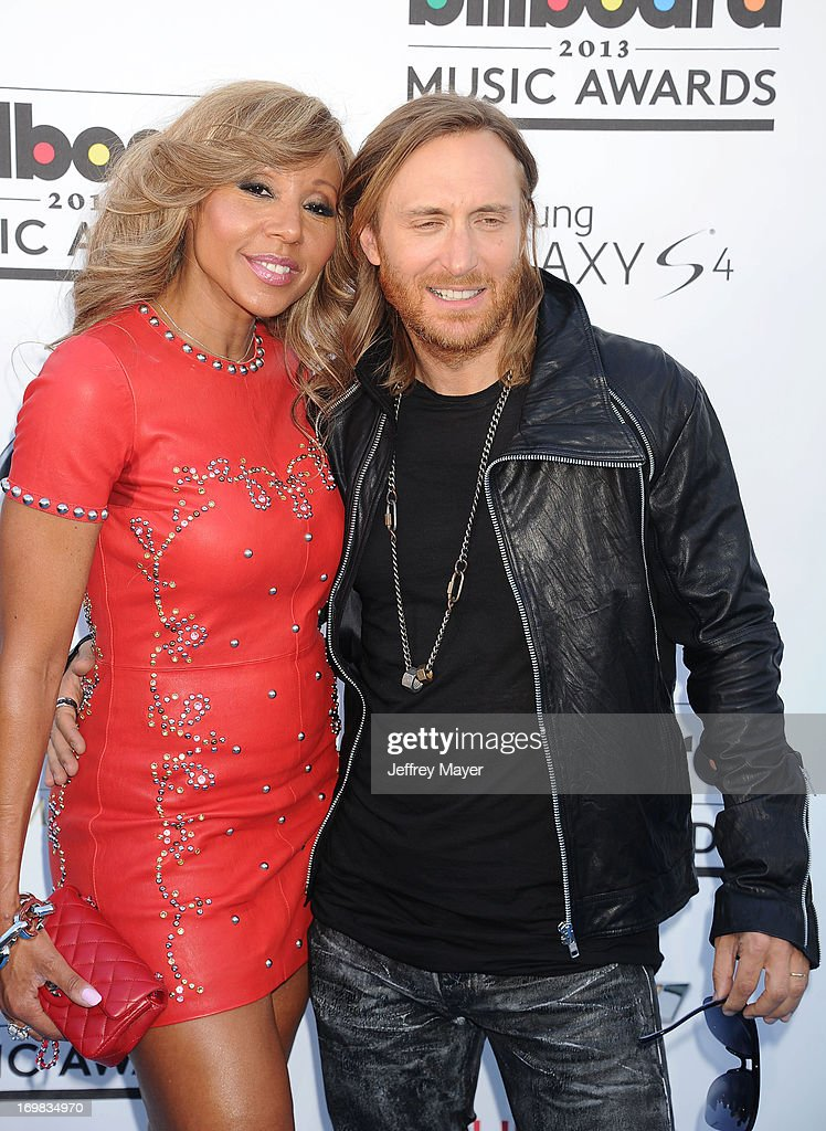 DJ <a gi-track='captionPersonalityLinkClicked' href=/galleries/search?phrase=David+Guetta&family=editorial&specificpeople=2825542 ng-click='$event.stopPropagation()'>David Guetta</a> (R) and <a gi-track='captionPersonalityLinkClicked' href=/galleries/search?phrase=Cathy+Guetta&family=editorial&specificpeople=624131 ng-click='$event.stopPropagation()'>Cathy Guetta</a> arrive at the 2013 Billboard Music Awards at the MGM Grand Garden Arena on May 19, 2013 in Las Vegas, Nevada.