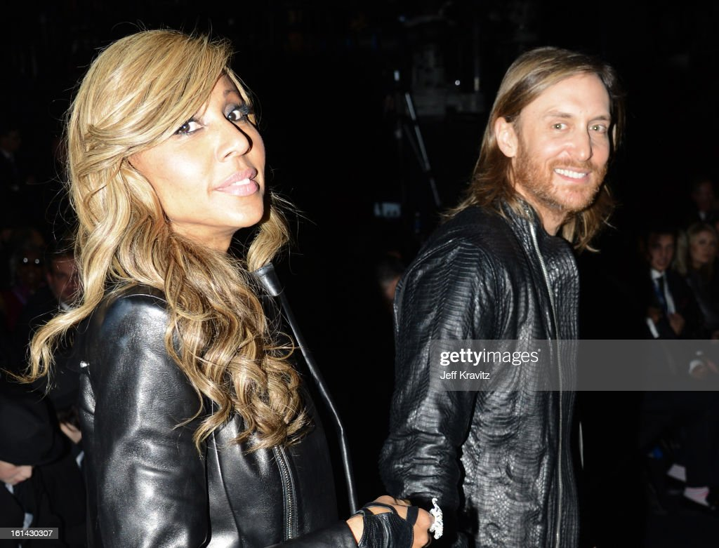 DJ <a gi-track='captionPersonalityLinkClicked' href=/galleries/search?phrase=David+Guetta&family=editorial&specificpeople=2825542 ng-click='$event.stopPropagation()'>David Guetta</a> (R) and <a gi-track='captionPersonalityLinkClicked' href=/galleries/search?phrase=Cathy+Guetta&family=editorial&specificpeople=624131 ng-click='$event.stopPropagation()'>Cathy Guetta</a> attend the 55th Annual GRAMMY Awards at Staples Center on February 10, 2013 in Los Angeles, California.