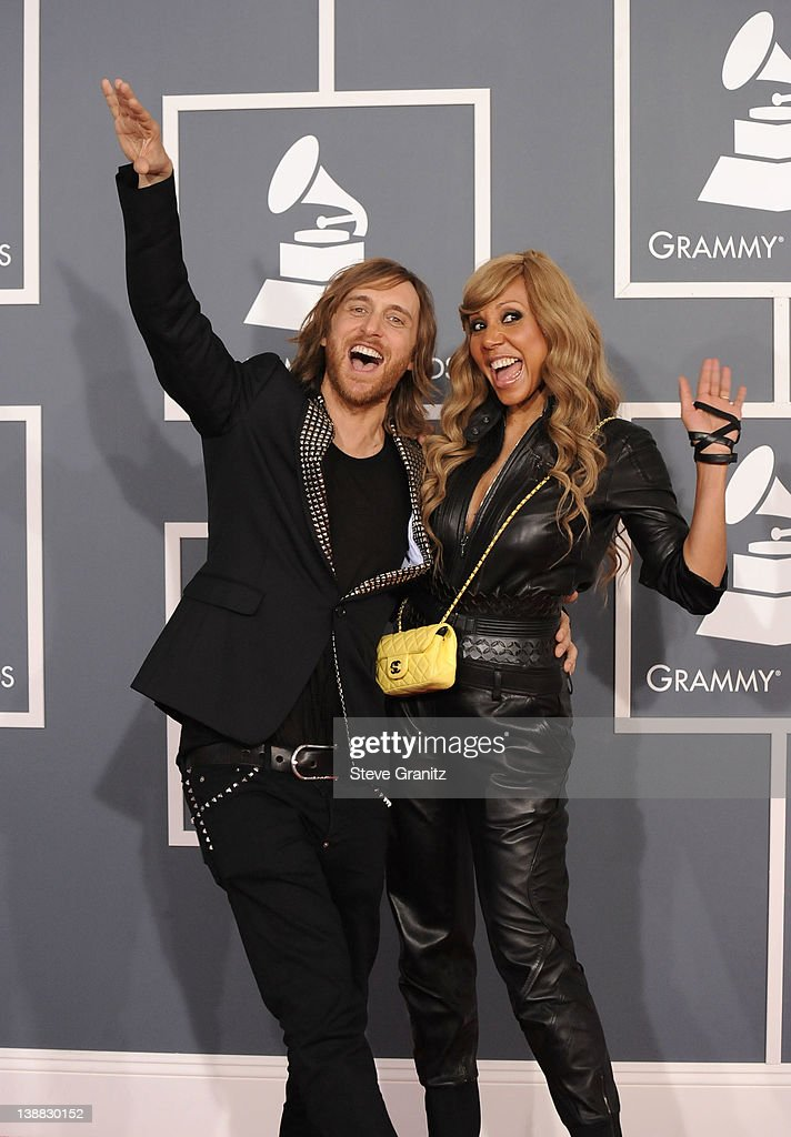 David Guetta and his wife Cathy Guetta arrive at The 54th Annual GRAMMY Awards at Staples Center on February 12 2012 in Los Angeles California
