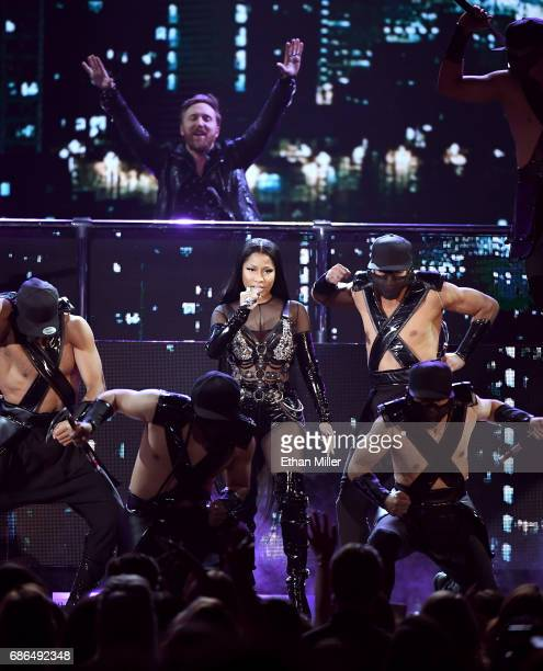 David Guetta and rapper Nicki Minaj perform onstage during the 2017 Billboard Music Awards at TMobile Arena on May 21 2017 in Las Vegas Nevada