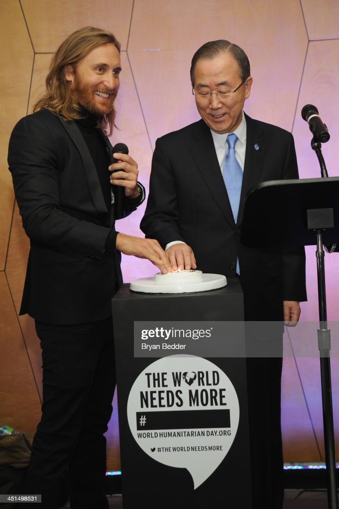 DJ David Guetta and UN Secretary-General Ban Ki-moon on stage at the premiere of David Guetta's new music video 'One Voice' onto the front of UN headquarters in support of 'The World Needs More____' Campaign on November 22, 2013 in New York City.