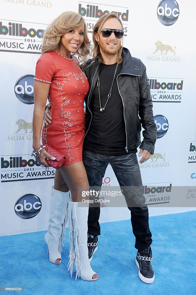 David Guetta and wife Cathy Guetta arrive at the 2013 Billboard Music Awards at MGM Grand Garden Arena on May 19 2013 in Las Vegas Nevada