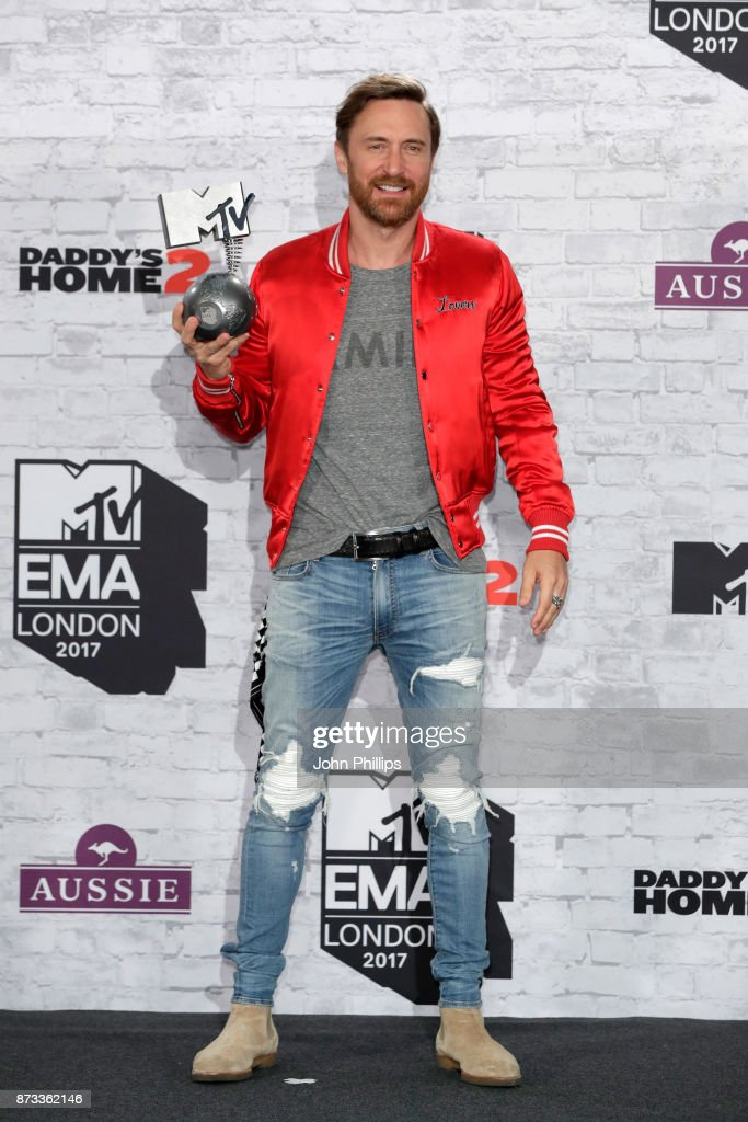 David Guetta poses with the Best Electronica award in the winner's room during the MTV EMAs 2017 held at The SSE Arena, Wembley on November 12, 2017 in London, England.