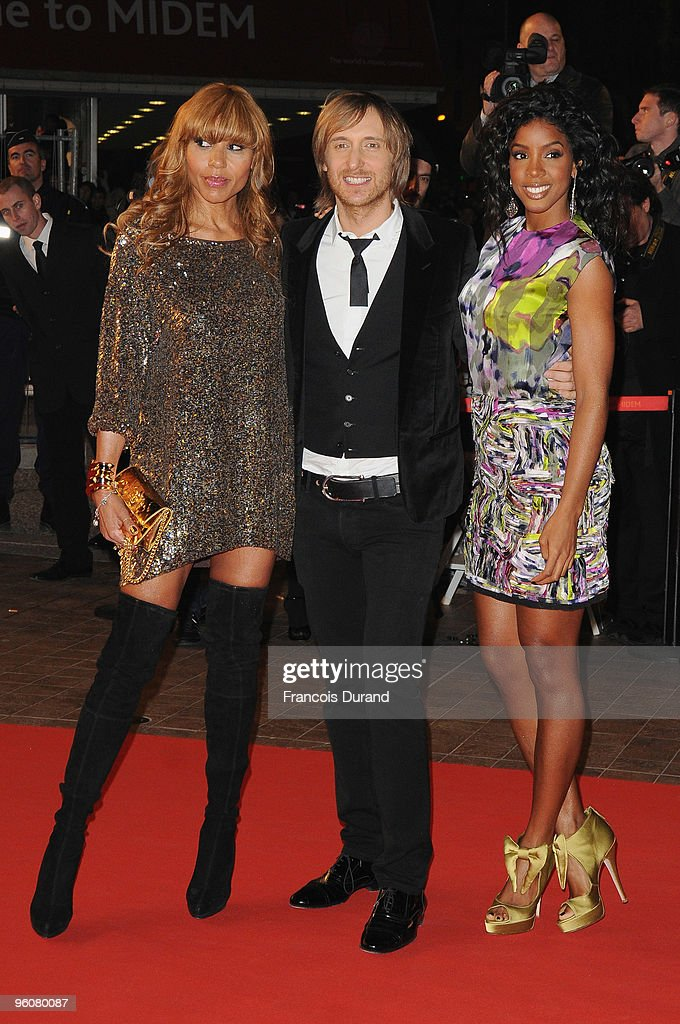 David Guetta wife Cathy Guetta and Kelly Rowland attend the NRJ Music Awards 2010 at Palais des Festivals on January 23 2010 in Cannes France