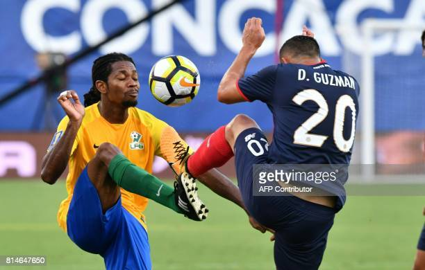 David Guzman of Costa Rica competes with Rudy Evans of French Guiana during during their CONCACAF Gold Cup match on July 14 2017 in Frisco Texas /...