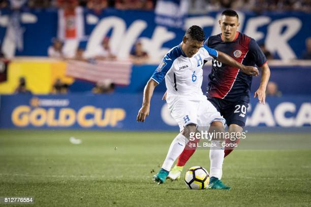 David Guzmán of Costa Rica looks to get the ball against Bryan Acosta of Honduras during the Group A CONCACAF Gold Cup Match between Honduras and...