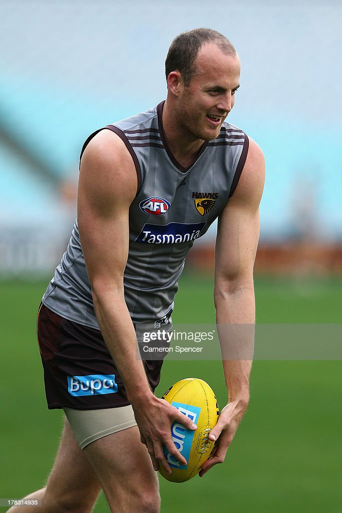 David Hale of the Hawks lines up a kick during a Hawthorn Hawks AFL training session at ANZ Stadium on August 29, 2013 in Sydney, Australia.