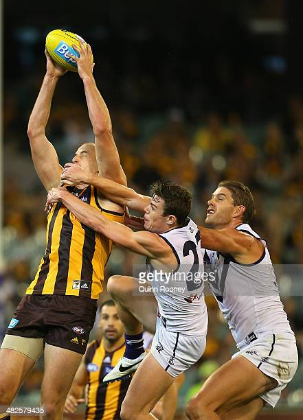 David Hale of the Hawks marks infront of Lachie Neale and Aaron Sandilands of the Dockers during the round three AFL match between the Hawthorn Hawks...