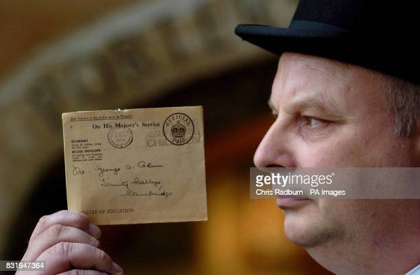David Hales Head Porter at Trinity College Cambridge University Cambridge holds a letter that was posted 56 years ago and finally delivered PRESS...
